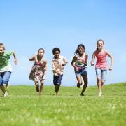 A group of children running outside