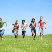 A group of children running outside